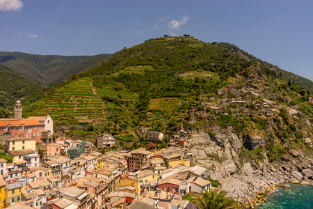 Europe, Italy, Cinque Terre, Vernazza, Vernazza, HIGH ANGLE VIEW OF TOWNSCAPE BY MOUNTAIN AGAINST SKY