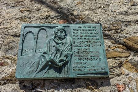 Vernazza, Cinque Terre, Italy - 26 June 2018: The stone inscription of Don Alberto Zanini of Vernazza, Cinque Terre, Italy Redakční