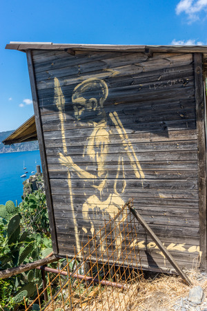 Vernazza, Cinque Terre, Italy - 27 June 2018: Warrior indian Graffiti on the walls of a wooden shed at Vernazza, Cinque Terre, Italy