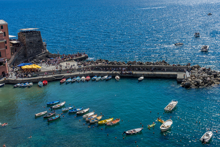 Vernazza, Cinque Terre, Italy - 26 June 2018: Boats docked near the shore at Vernazza, Cinque Terre, Italy