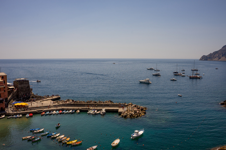 Vernazza, Cinque Terre, Italy - 27 June 2018: Boats docked near the shore at Vernazza, Cinque Terre, Italy