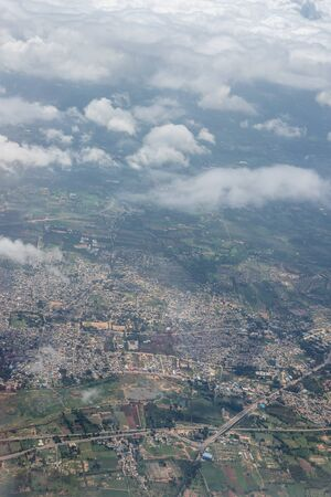 Bangalore to Pune,, a view of a city with a mountain in the background