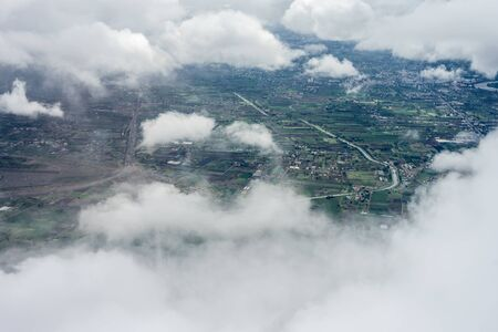 Bangalore to Pune,, smoke coming from the clouds 免版税图像
