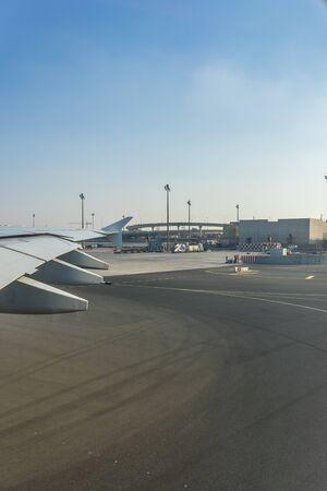 Dubai, Emirates - 18 November 2018: view of emirates plane through a window