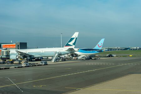 Schiphol, Amsterdam, Netherlands - 4 November 2018 : TUI and Cathay Pacific planes waiting at the airport dock