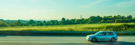 Germany, Frankfurt, Sunrise, Outkirts, a car parked on the side of a road Banco de Imagens