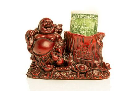 smiling buddha: Smiling red buddha with green dollar