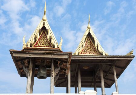 sheds: Two wooden sheds with a large bell in thai style