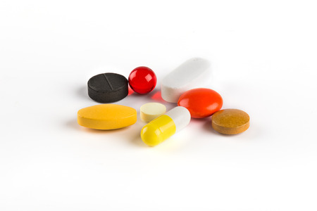 pilule: Group of colorful pills and supplements on white background