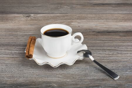 teaspoon: Cup of espresso with stick of cinnamon. With teaspoon