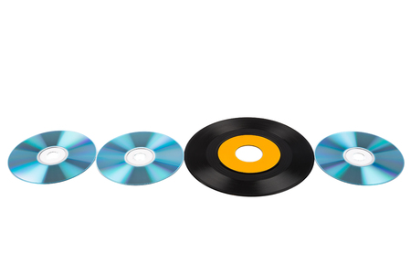 discs: Cd discs and vinyl record in a row. Isolated on white background