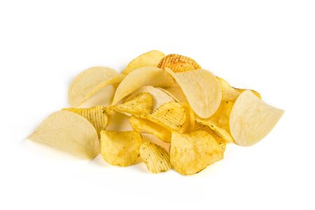ridged: Potato chips of different kinds. Heap. Yellow, salty, ridged. Isolated on white background Stock Photo