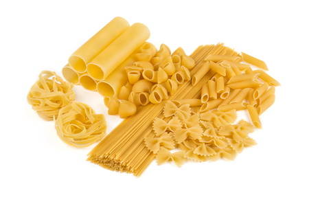 kinds: Variety of pasta. Macaroni. Uncooked. Many kinds. Isolated on white
