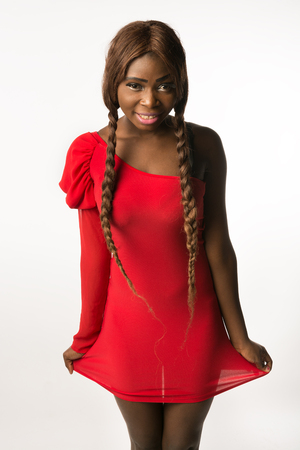 slinky: Beautiful african-american woman in red sexy slinky dress smiling. Isolated