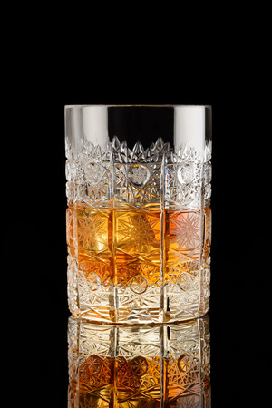whiskey on the rocks: Glass of whisky with ice cubes. Whiskey on the rocks. Close up. Pattern