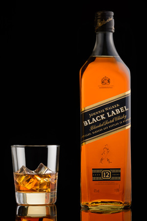 12 13 years: Moscow, Russia. May 13, 2016. Black label. Johnnie walker. Blended scotch whisky. 12 years. Bottle and glass with ice. Black background