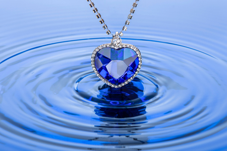 Sapphire pendant. Heart of the ocean and circles on the water