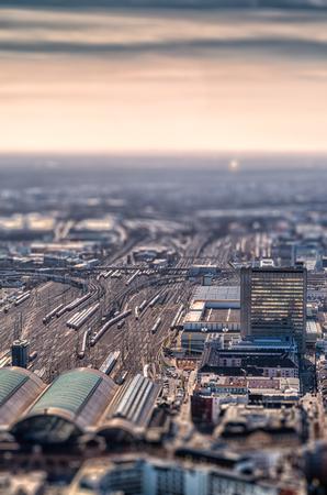 tilt and shift: Train station at sunset. Tilt shift effect. Frankfurt, Germany Stock Photo
