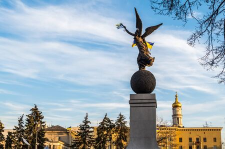 kharkov: Statue of Ukraine liberty in Kharkov with flag Stock Photo