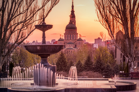 Sunset in Kharkov with fountain and cathedral