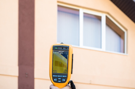 thermogram: Heat Loss Detection of thewindow using Infrared Thermal Camera Stock Photo