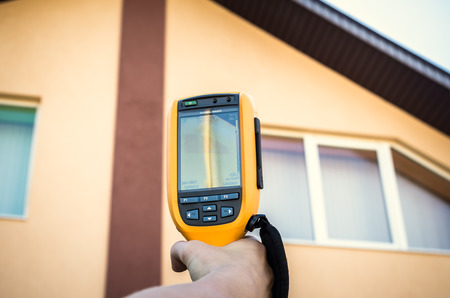 thermogram: Recording Heat Loss of roof and window With Infrared Thermal Camera Stock Photo