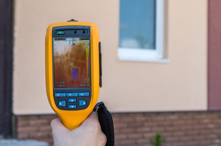 Infrared inspection of heat loss of window at house