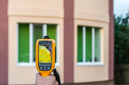 thermal imaging: Thermal imaging inspection of house with thermovisor