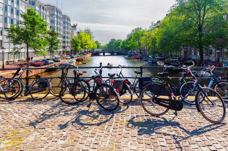 dutch typical: Bicycles on bridge, canals of Amsterdam, Netherlands