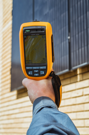 thermogram: Recording Photovoltaic Solar Panels on the wall House With Thermal Camera