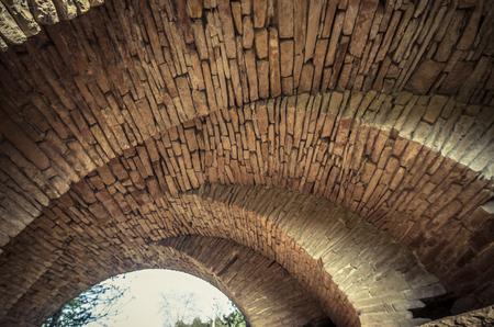 View of the arcs of the old historic stone bridge located in Ukraine Imagens