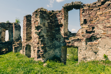 Ruins of old castle in West Ukraine at spring time