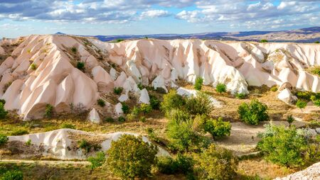 Mountain landscape in Pigeon valley in Cappadocia, Turkey. Amazing landscapes and rock formations of Cappadocia. Traveling the world concept.