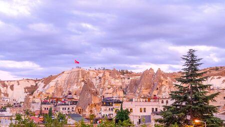 Goreme, Cappadocia, Turkey on sunset. Famous center of balloon fligths. 写真素材