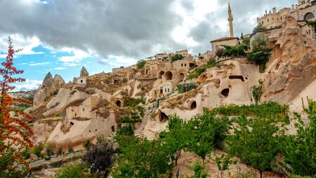 Unreal world of Cappadocia. Colorful Pigeon valley. Uchisar village located, Nevsehir Province in the Cappadocia region of Turkey, Asia. Traveling concept background