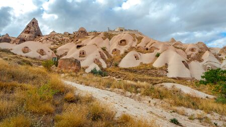 Mountain landscape in Pigeon valley in Cappadocia, Turkey. Unreal rock formations of Cappadocia