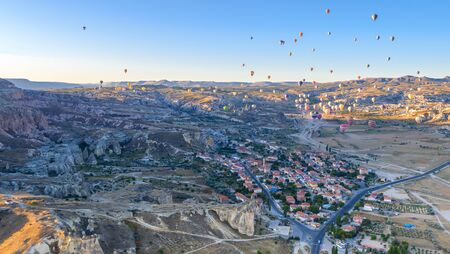 Aerial view of air balloon over valleys Cappadocia, Turkey. Aerial view from air balloon over road in Goreme, Cappadocia, Turkey. Aerial balloon over mountains at sunrise, Cappadocia, Turkey.