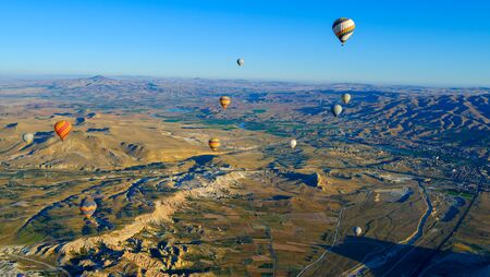 View of the air balloon flying over rock formation in Cappadocia, Turkey