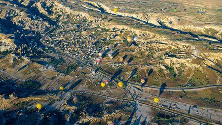 Hot air balloon flying over rock landscape at Cappadocia Turkey 写真素材