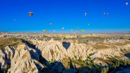 Hot Air Ballooning in the Canyons of Cappadocia, air balloon aerial view 写真素材