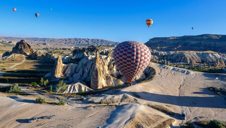 Hot Air Balloon Overflight Cappadocia. Beautiful aerial view of unique rocks of Cappadocia with balloons