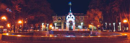 Panoramic view of mirror stream or glass stream in winter night - the first symbol of the city of Kharkiv, a fountain in the heart of the city illuminated by night