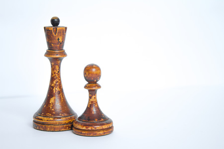 Old chess Board with wooden pieces on a white background. Stock Photo