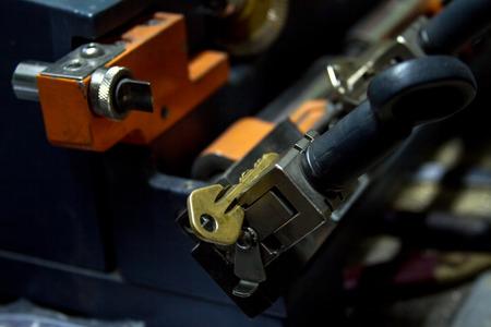 Machine production of duplicate metal keys. The key of the yellow metal.