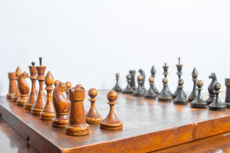 chess board: Old chess Board with wooden pieces.