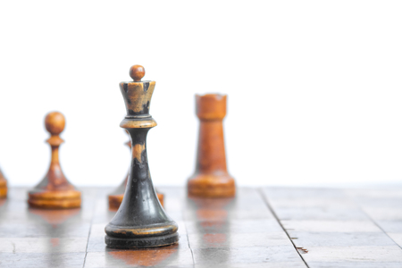 chess board: Old chess Board with wooden pieces on a white background