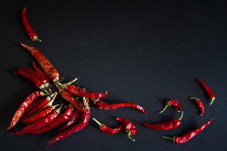 bell peper: Red chili pepper on a black background Stock Photo