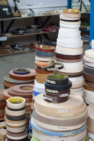 Furniture accessories. Multicolored bobbins of PVC edge and melanin for the manufacture of furniture.