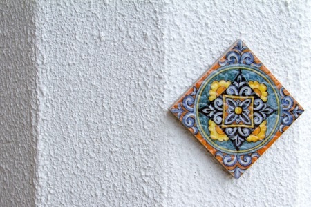 One ceramic tile with oriental pattern on a white background.
