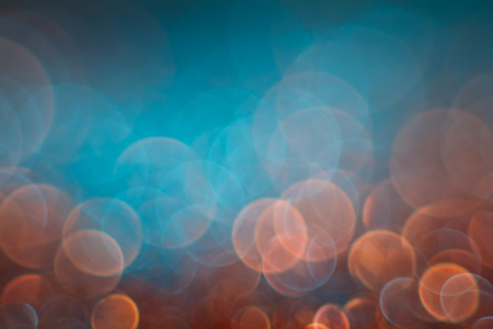 Abstraction orange bokeh on a blue background. Defocused. Reklamní fotografie - 112888757